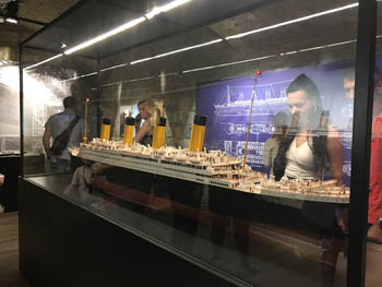 a large scale model of the Titanic in a glass cabinet