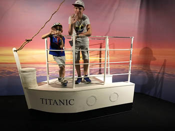 our 2 boys (aged 5 and 12) on mock up stern of the Titanic