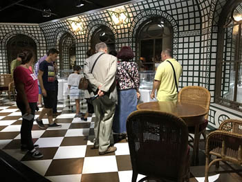 visitors viewing the reconstructed cafe
