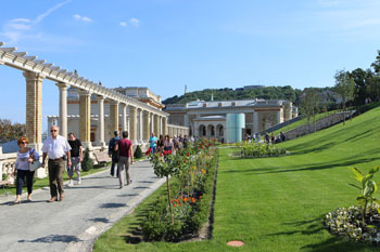 a colonnaded walkway and a park