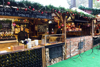 food and Xmas gift vendors' wooden cottages decorated with fir and red globes