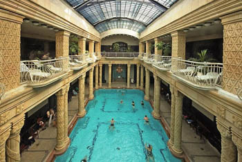 swimming pool and the clonnaded interior of the bath