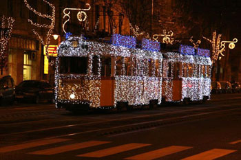 tran No. 49 decorated with strings of light