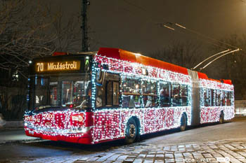 a red trolley bus No. 70 with strings of LEdD lights
